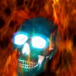 Magic skull in fire - Stock Photo