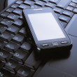 Phone on a laptop — Stock Photo #6912291