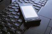 Phone on a laptop — Stock Photo
