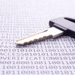 Key is on list with binary code — Stock Photo #7216212