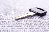 Key is on the list with a binary code — Stock Photo