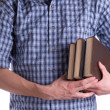 Men's holding a three books - Stock Photo