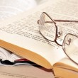 Eyeglasses on open books — Stock Photo #7185051