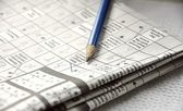 Close up of crossword and pencil — Stock Photo