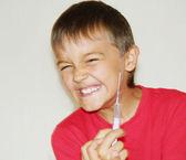 Boy with a syringe — Stock Photo