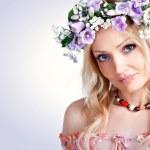 Cute blonde wearing a wreath of flowers — Stock Photo