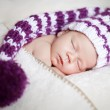 Cute newborn baby sleeps in a hat — Stock Photo #7028079