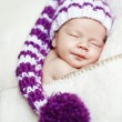 Cute newborn baby sleeps in a hat — Stock Photo #7028102