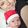 Happy mother and child santa — Stok fotoğraf