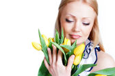 Beautiful blonde girl with tulips — Stock Photo