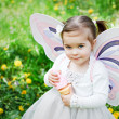 Sweet girl with butterfly wings — Stock Photo