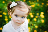 Cute little girl with a watchful eye — Stock Photo
