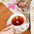 Cup of tea and a book on the table — Stock Photo