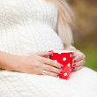 Red cup in the hands — Stock Photo