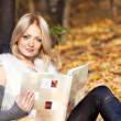 Girl with book in autumn forest — Stock Photo #7542703