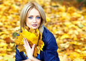 Cute blonde with a bouquet of autumn leaves — Stock Photo