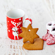 Christmas mug with deer, gingerbread and Santa's boots — Stock Photo