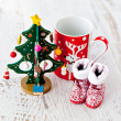 Stock Photo: Christmas tree and Santa's boots and a cup