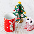 Christmas tree and Santa's boots and a cup — Stock Photo