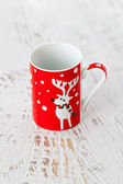 Christmas cup with a deer — Stock Photo