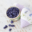 Sachets and petals of violets in sugar — Stock Photo #7580826