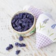 Sachets and petals of violets in sugar - Stock Photo