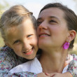 Daughter hugging her mother — Stock Photo