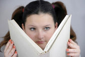 Schoolgirl with a big book — Stock Photo