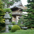 Stone Lantern by Japanese Garden Entrance - Stock Photo