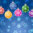 Hanging Ornaments on Blurred Snowflakes Background Horizontal — Stock Photo #7352623