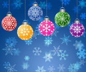 Hanging Ornaments on Blurred Snowflakes Background Horizontal — Stock Photo