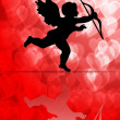 Valentine's Day Cupid on Hearts Blurred Background — Stock Photo #7497930