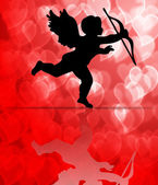 Valentine's Day Cupid on Hearts Blurred Background — Stock Photo