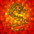 Royalty-Free Stock Photo: Golden Metallic Chinese Dragon on Red Blurred Background