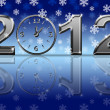 Silver 2012 Happy New Year Clock with Snowflakes — Stock Photo