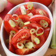 Fresh tomato salad with spring onions in a bowl — Stock Photo