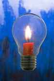 Candle in bulb — Stock Photo