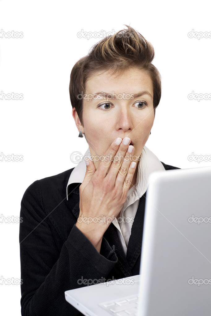 Woman is shocked by what she sees on the laptop monitor — Stock Photo #6865282
