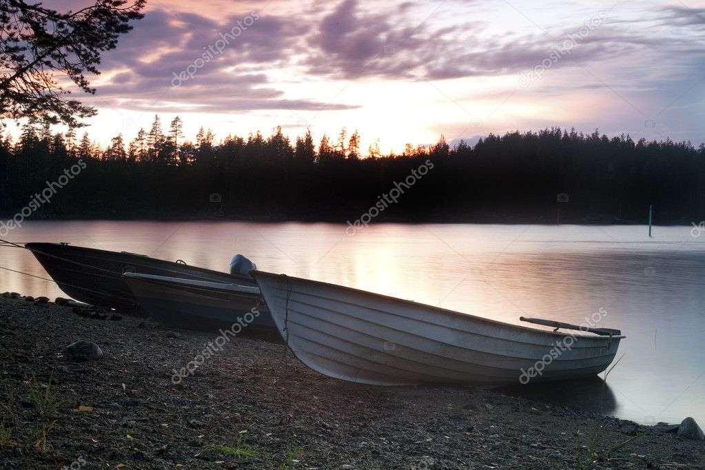 Three Fishing boat on the shore at evening  Stock Photo #7144511