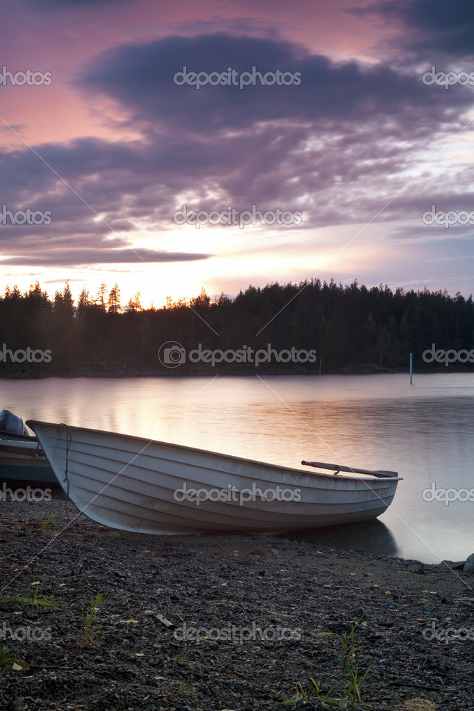 Fishing boat on the shore at evening  Stock Photo #7144584