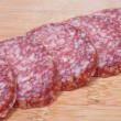 Stock Photo: Food background of sliced salami