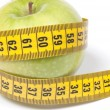 Stock Photo: Green Apple with measuring tape, isolated on white