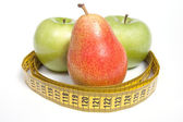 Green Apples and Pear with measuring tape, isolated on white — Stock Photo