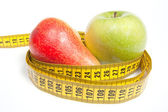 Green Apple and Pear with measuring tape, isolated on white — Stock Photo