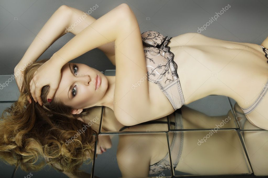 Beautiful lady in the mirror — Stock Photo #7845841