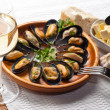 Mussels in garlic butter sauce - Stock Photo