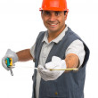 Isolated manual worker using a tape measure - Stock Photo