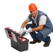 Isolated worker looking for a drill - Stock Photo