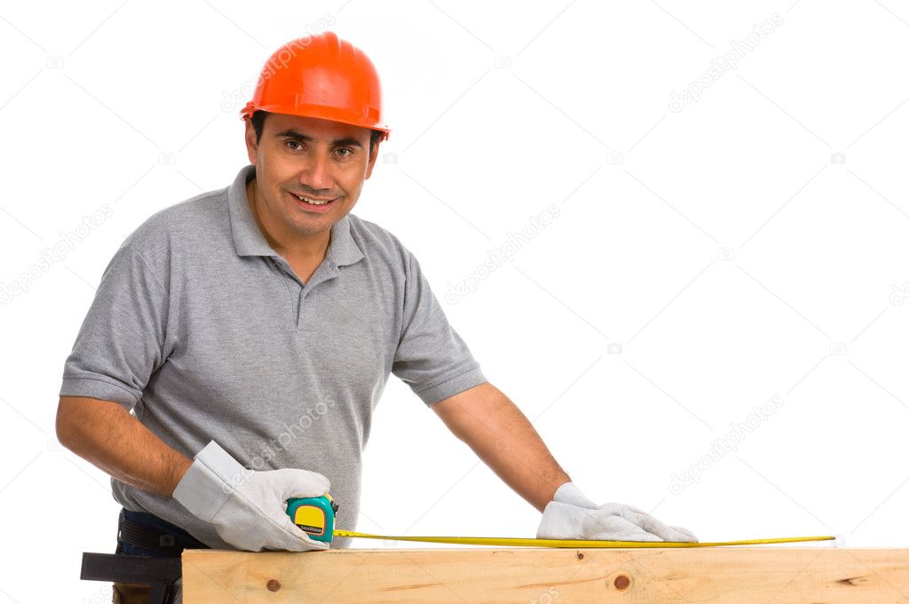 Isolated worker using a tape measure — Stock Photo #6839457
