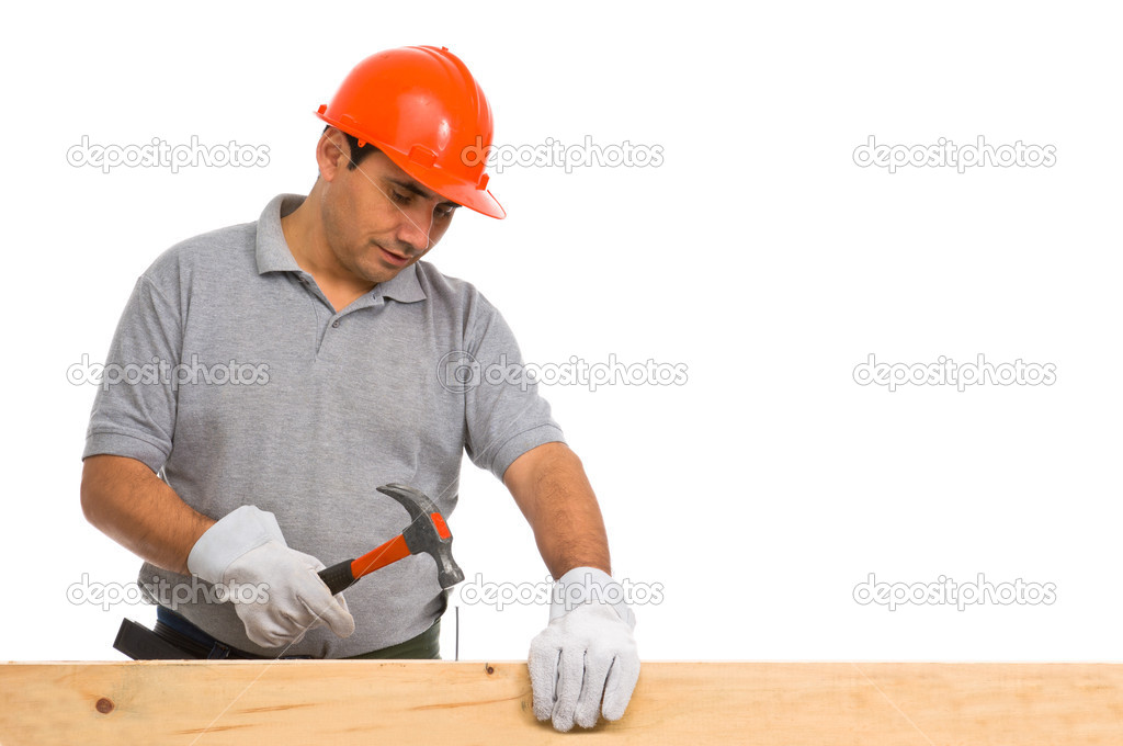 Isolated worker using a hammer — Stock Photo #6839633